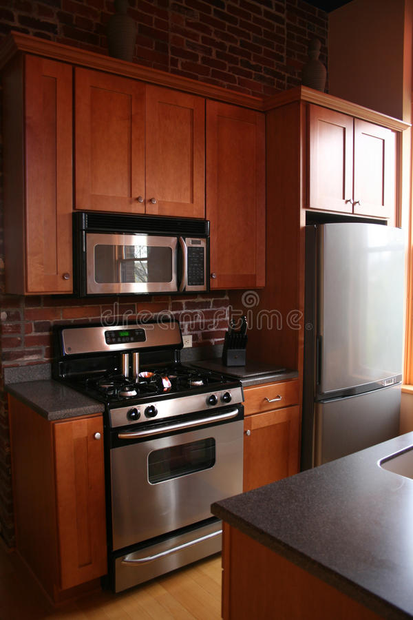 Upscale kitchen wood cabinets stainless stock images