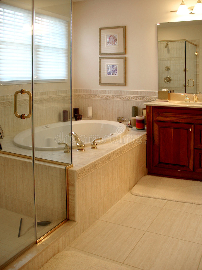 Upscale Master bath. Room with jet tub and glass shower