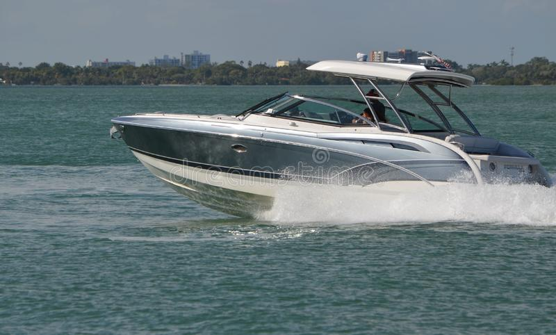 Upscale motorboat with white fiberglass canopy stock photo