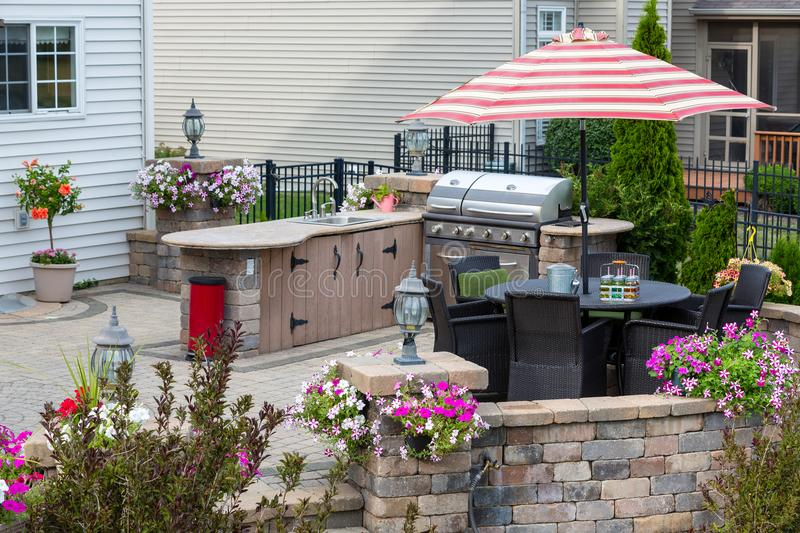 Upscale outdoor patio with kitchen area stock images