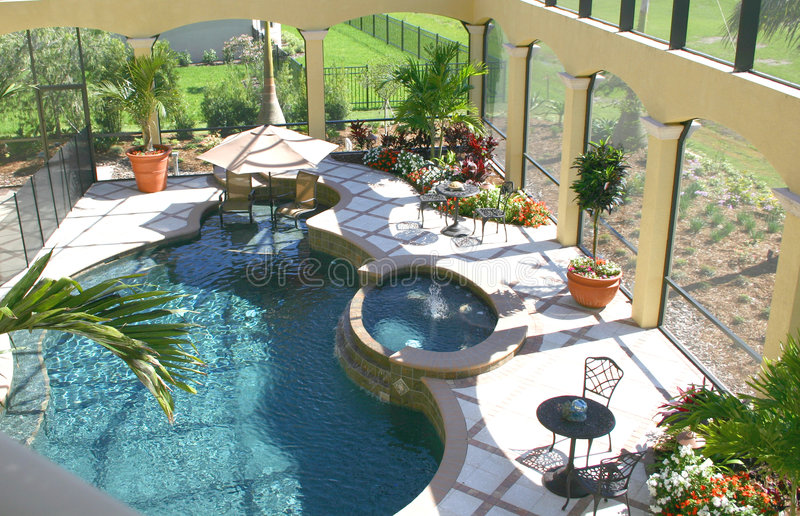 Upscale Patio. Luxurious covered patio with pool, and tropical flowers and trees stock photos