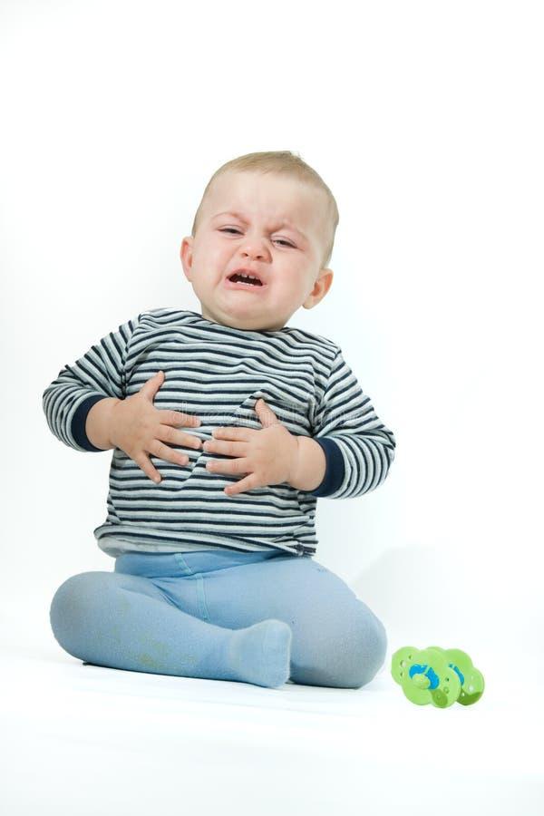 Upset baby stock photos
