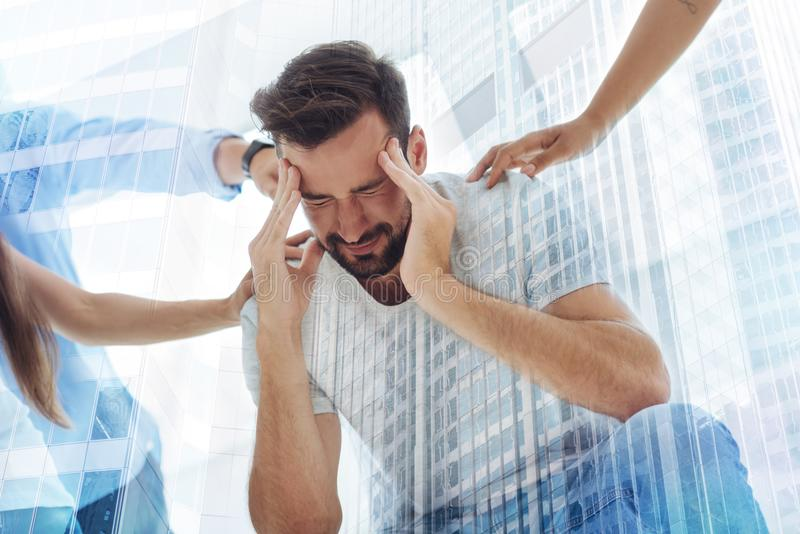 Upset bearded man with his eyes closed stock image