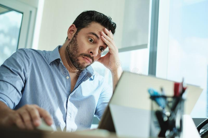 Worried Businessman Got Virus and Data Loss on Laptop Computer stock images