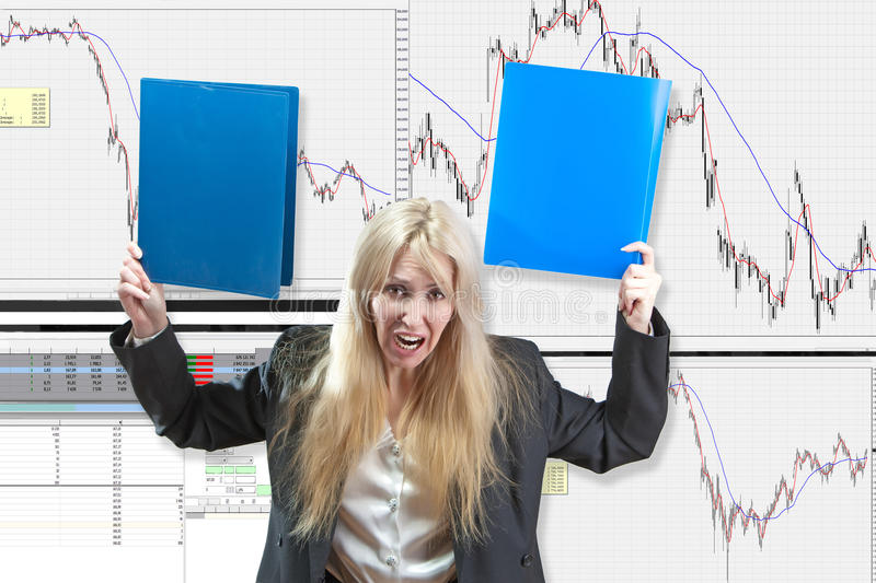 The upset business woman a financial analyst. Against falling of courses of the market stock photography