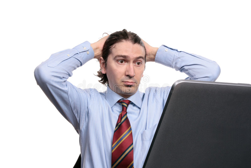 Upset businessman with laptop royalty free stock photos