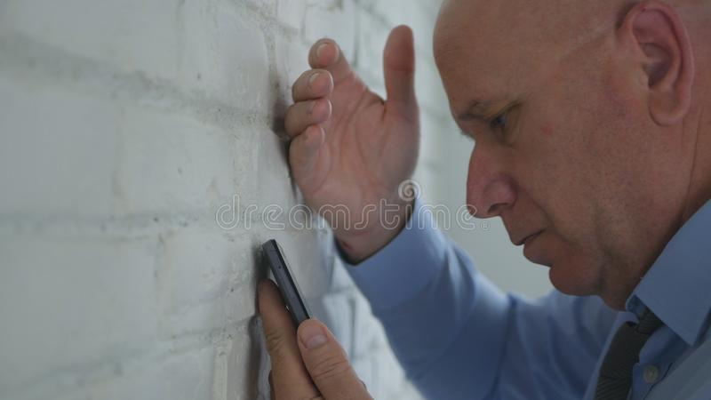 Upset Businessman Looking Disappointed on Cell Phone Text. Image with Upset Businessman Looking Disappointed on Cell Phone Text royalty free stock images