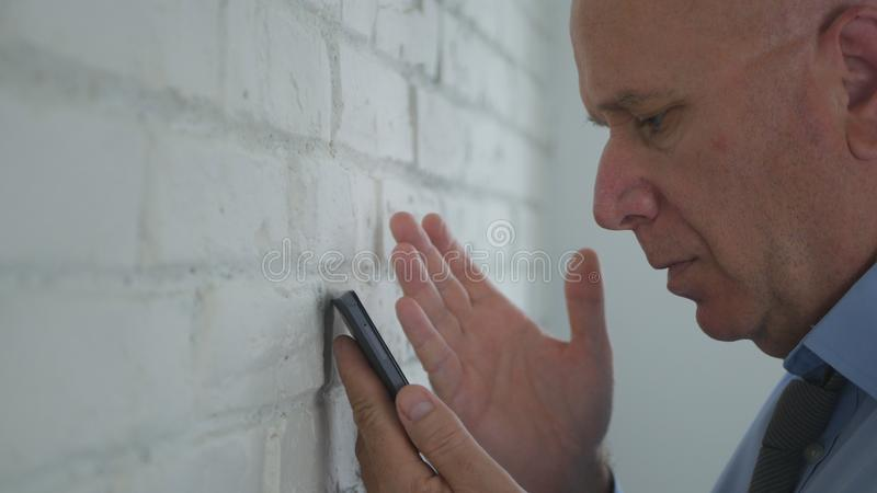 Upset Businessman Looking Disappointed on Cell Phone Text. Image with Upset Businessman Looking Disappointed on Cell Phone Text royalty free stock photo