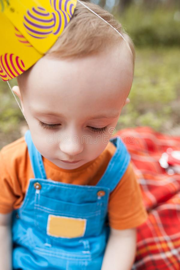 Upset child party picnic nature concept. stock photography