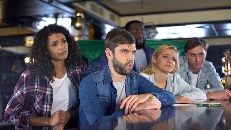 Upset about defeat fans with Brazilian flag supporting national team, game loss stock photography