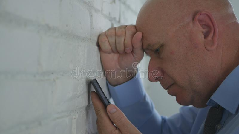 Upset and Disappointed Businessman Reading Bad Financial News on Mobile Phone.  stock photo
