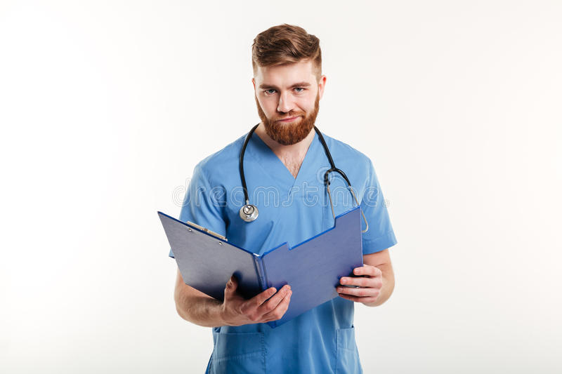 Upset disappointed medical doctor or a nurse with stethoscope royalty free stock images