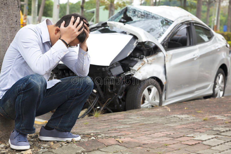 Upset driver After Traffic Accident. He is so regretful stock image