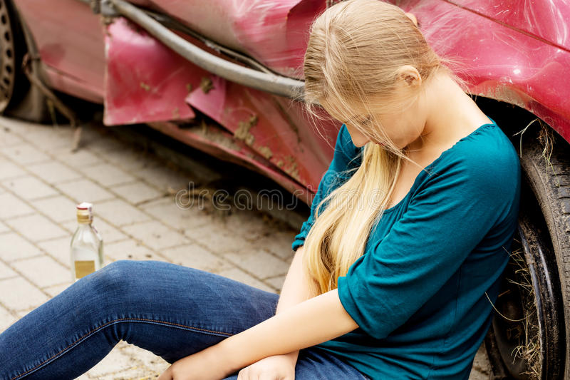 Upset driver woman in front of automobile crash car. royalty free stock images