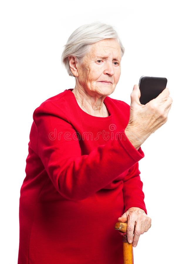 Upset elderly woman using touch screen mobile royalty free stock images