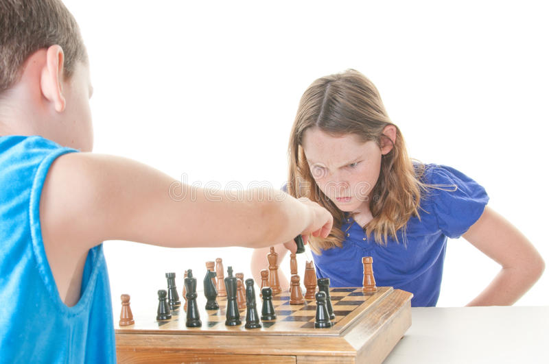Upset girl during chess game stock photo