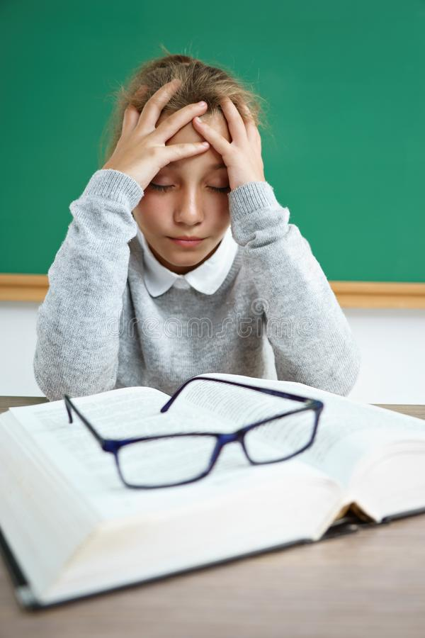 Upset girl holding her head. royalty free stock photography