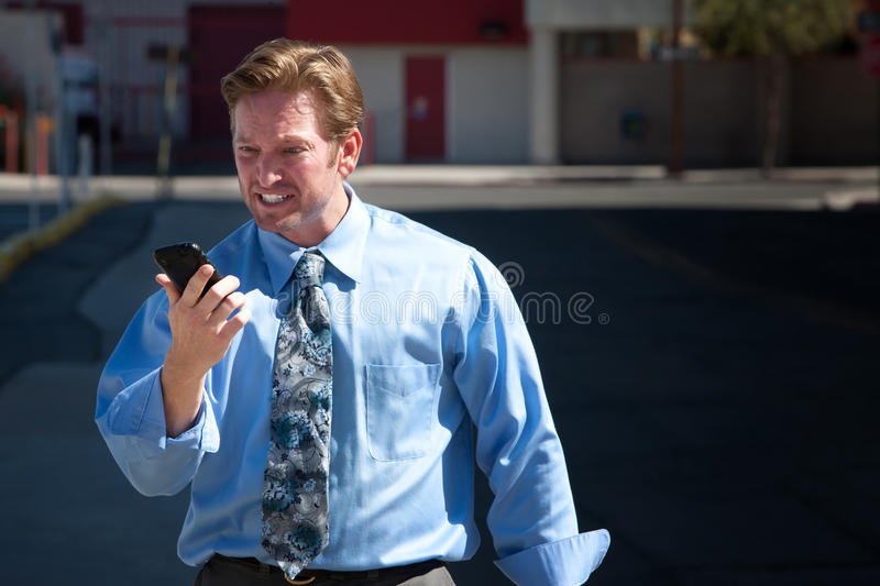 Upset, good-looking man angry with cell phone.