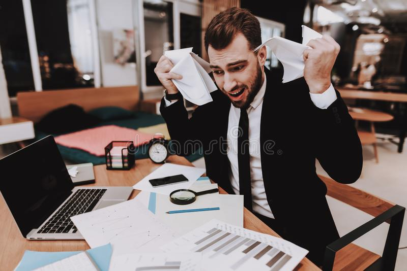 Upset. Large Amount of Work. Business Suit. Sit. Upset Large Amount of Work Business Suit Workplace Ideas Project Laptop Sit Brainstorm Young Guy Businessman royalty free stock photo