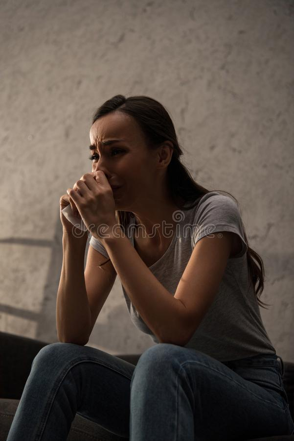 upset lonely woman crying and holding napkin royalty free stock photo