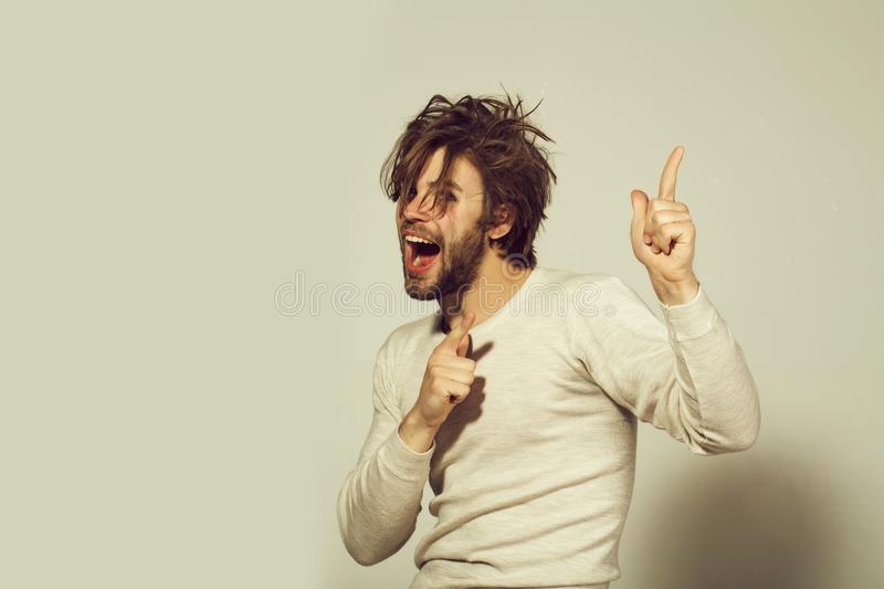 Upset man happy man with long uncombed hair wake up in morning. Upset man happy man in morning with disheveled and uncombed long hair with beard on face in white stock image