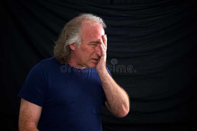 Upset Man Holding Face Stock Images