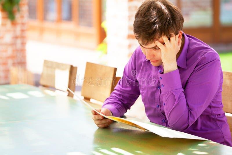 Download Upset Man Looking In The Menu Stock Photo - Image: 31407778