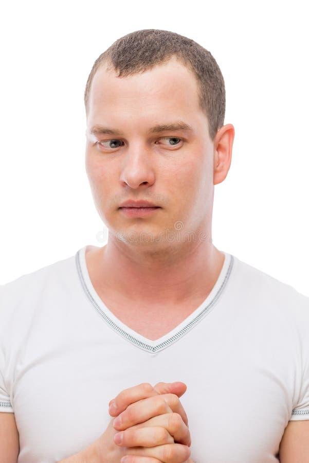 Upset man 30 years thinking, portrait. On a white background royalty free stock image