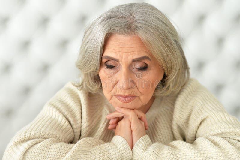 Upset mature woman stock photos
