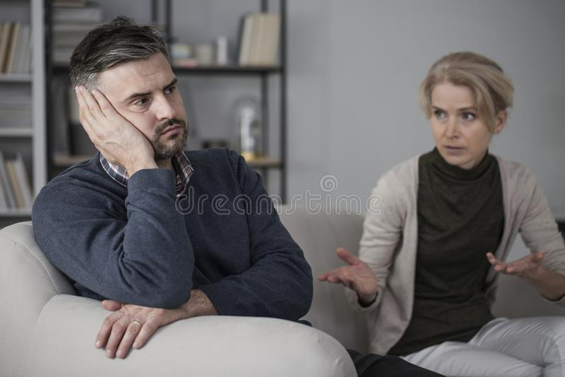 Upset man and complaining wife royalty free stock image