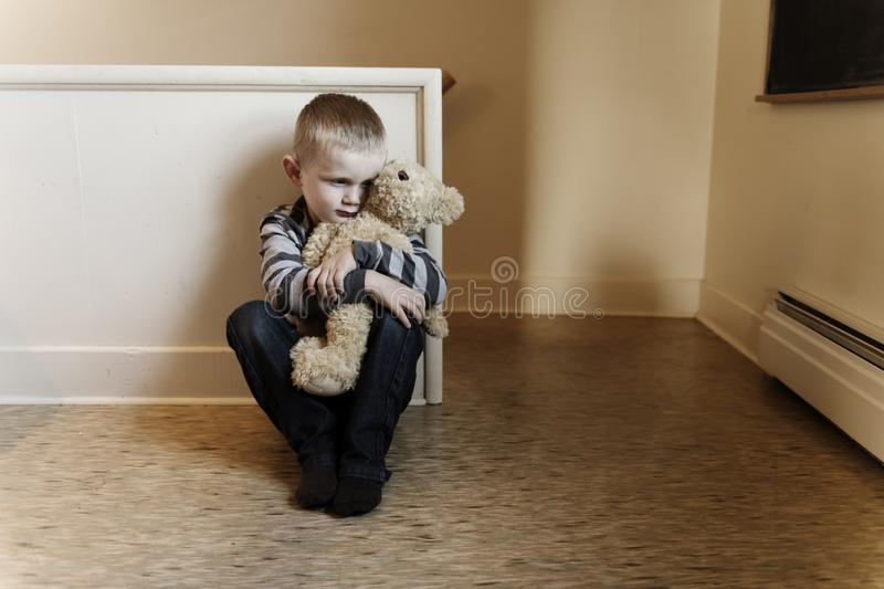 Upset problem child close to the staircase concept for bullying, depression stress. Or frustration royalty free stock photos