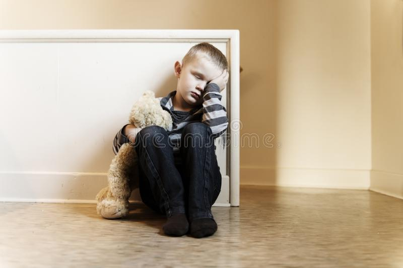 Upset problem child close to the staircase concept for bullying, depression stress. Or frustration royalty free stock images