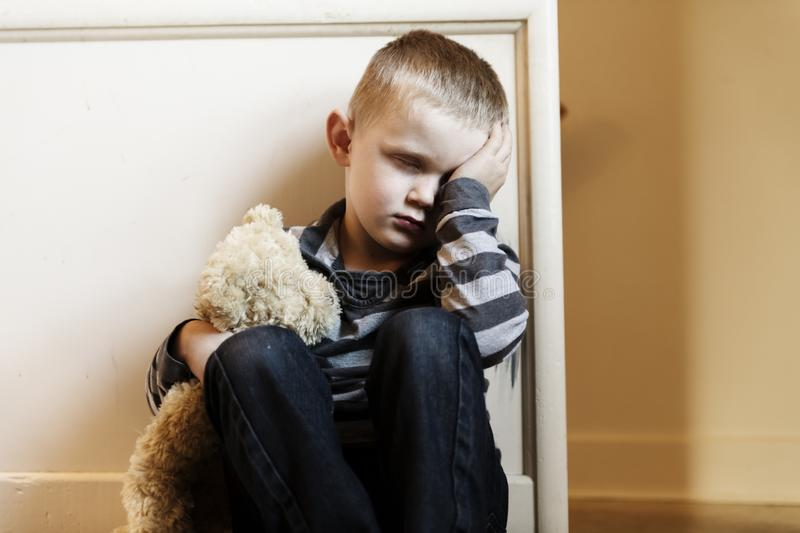 Upset problem child close to the staircase concept for bullying, depression stress. Or frustration stock photos