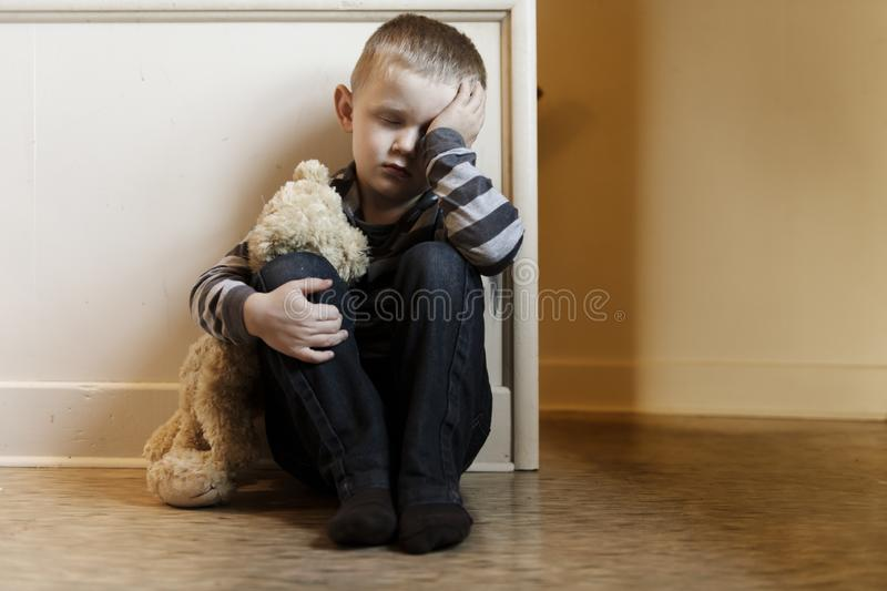 Upset problem child close to the staircase concept for bullying, depression stress. Or frustration stock images