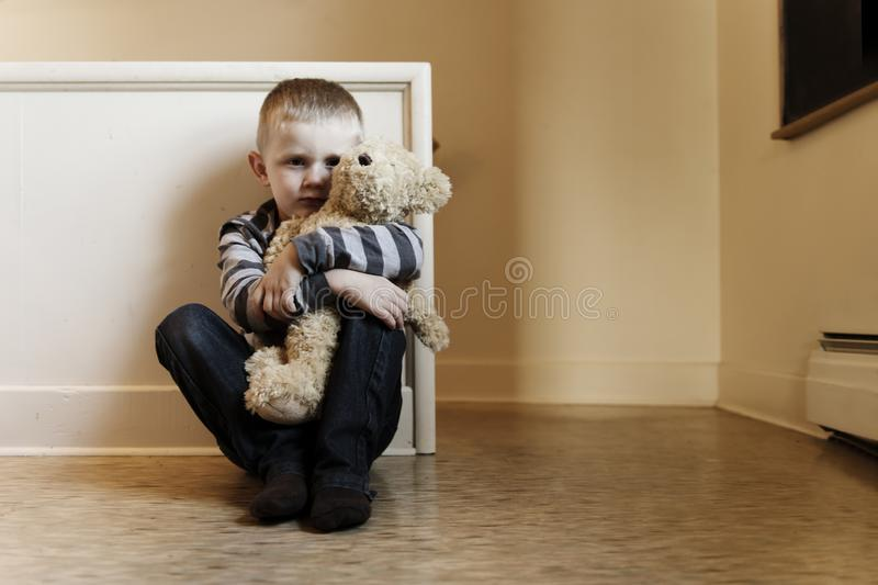 Upset problem child close to the staircase concept for bullying, depression stress. Or frustration stock image