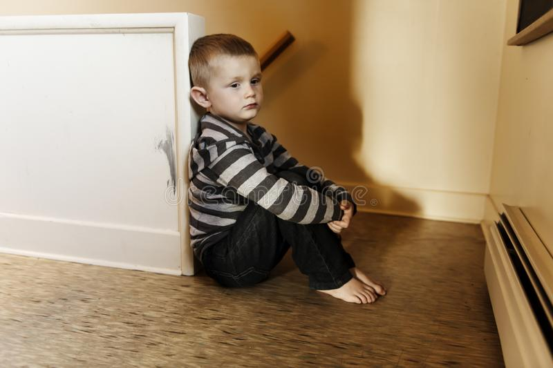 Upset problem child close to the staircase concept for bullying, depression stress. Or frustration stock photo