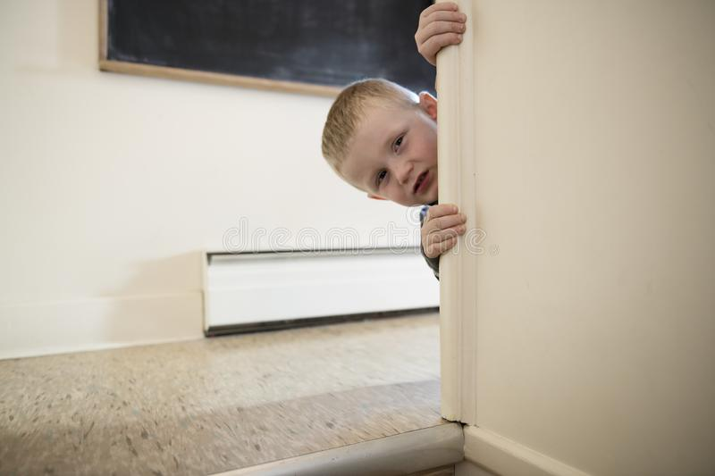 Upset problem child close to the staircase concept for bullying, depression stress. Or frustration royalty free stock photo