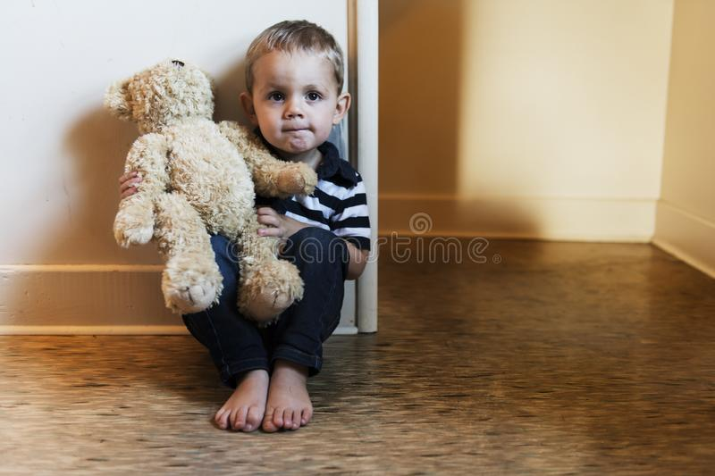 Upset problem child close to the staircase concept for bullying, depression stress. Or frustration royalty free stock image