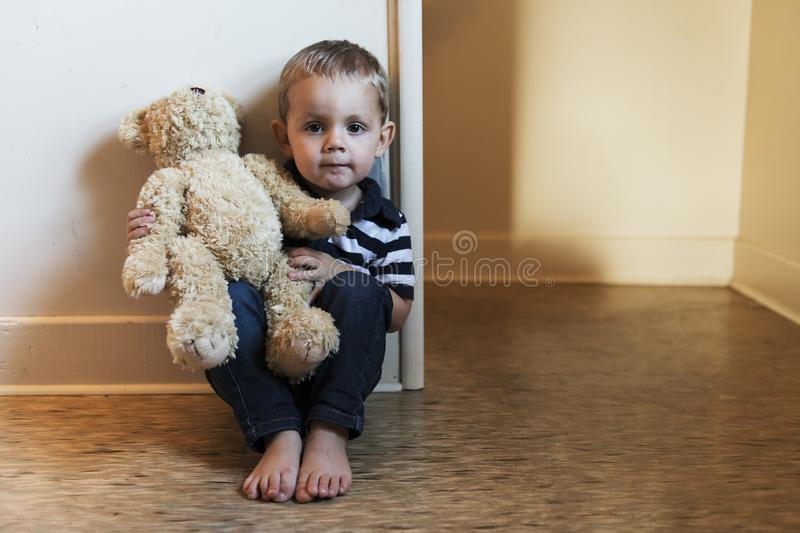 Upset problem child close to the staircase concept for bullying, depression stress. Or frustration stock photography