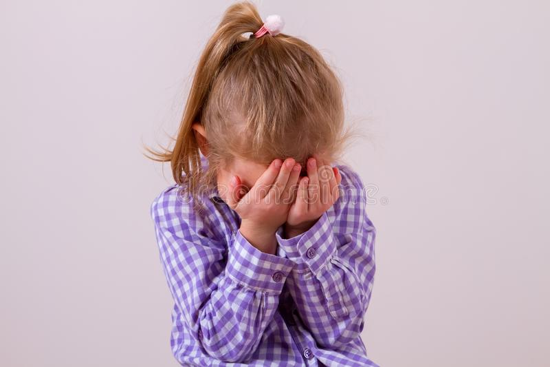 Upset problem child with head in hands. Concept for bullying, depression stress or frustration royalty free stock images