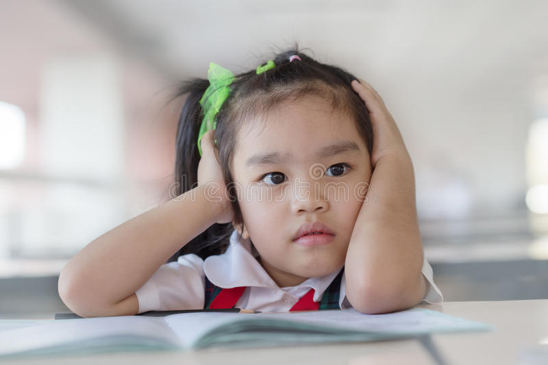 Upset problem child with head in hands. Education and school concept Upset problem child with head in hands royalty free stock image