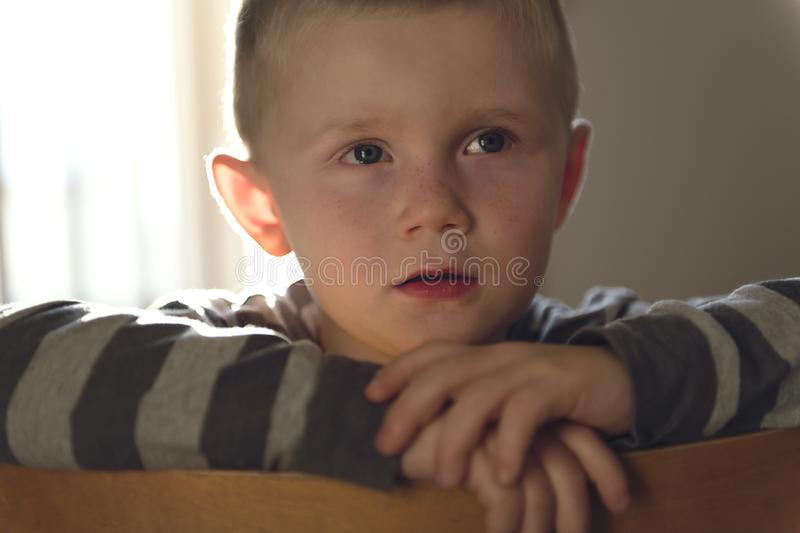 Upset problem child sit on chair concept for bullying, depression stress. A Upset problem child sit on chair concept for bullying, depression stress royalty free stock images