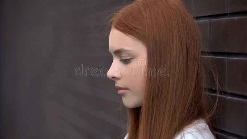 Upset red-haired young woman, frustrated female teenager, melancholy sadness royalty free stock photography