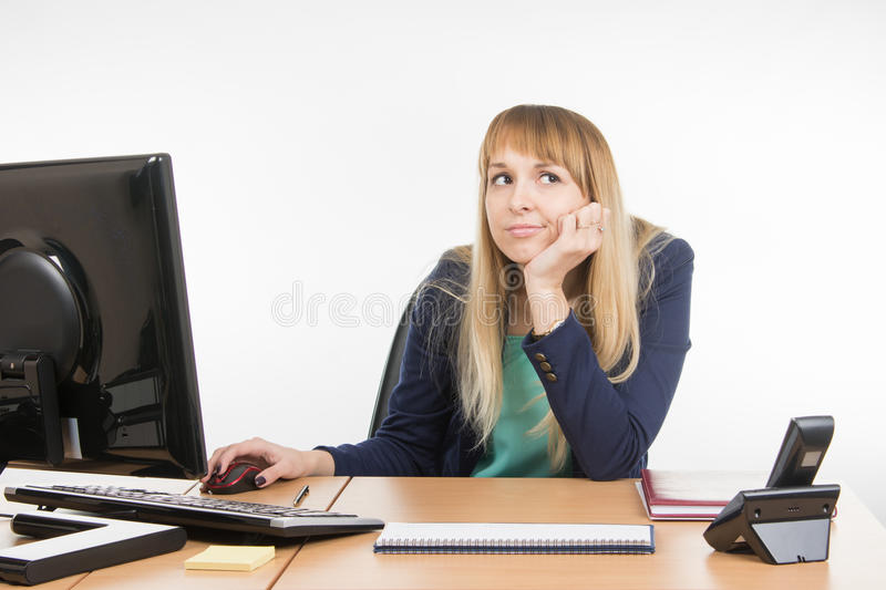 Upset a specialist office at the workplace. Young woman secretary sitting at office desk working, isolated on white background stock image