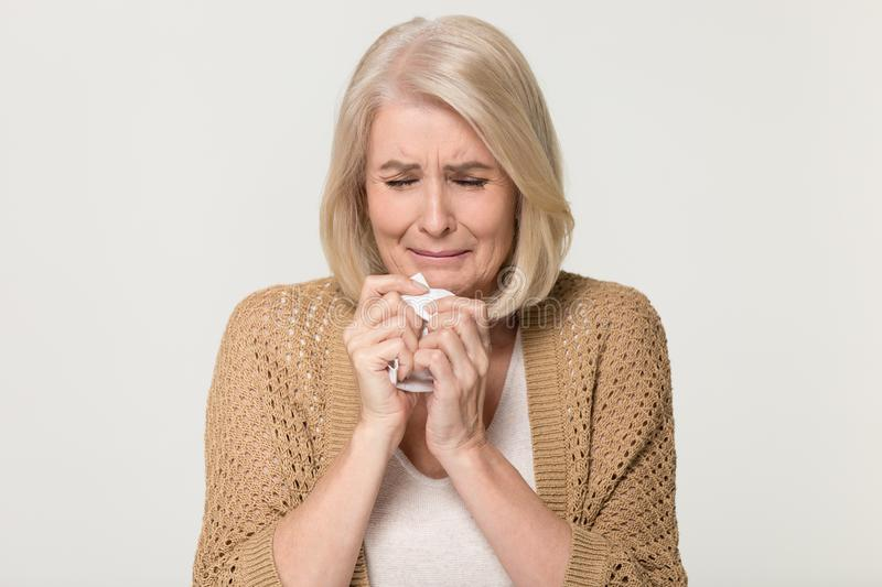 Upset stressed old woman crying feeling loneliness isolated on background royalty free stock photos