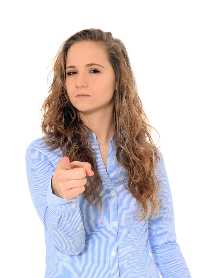 Upset teenage girl points with finger royalty free stock images