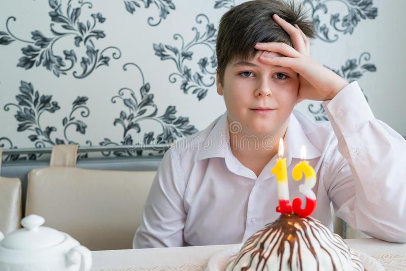 Upset teenager alone marks a thirtieth birthday royalty free stock photography