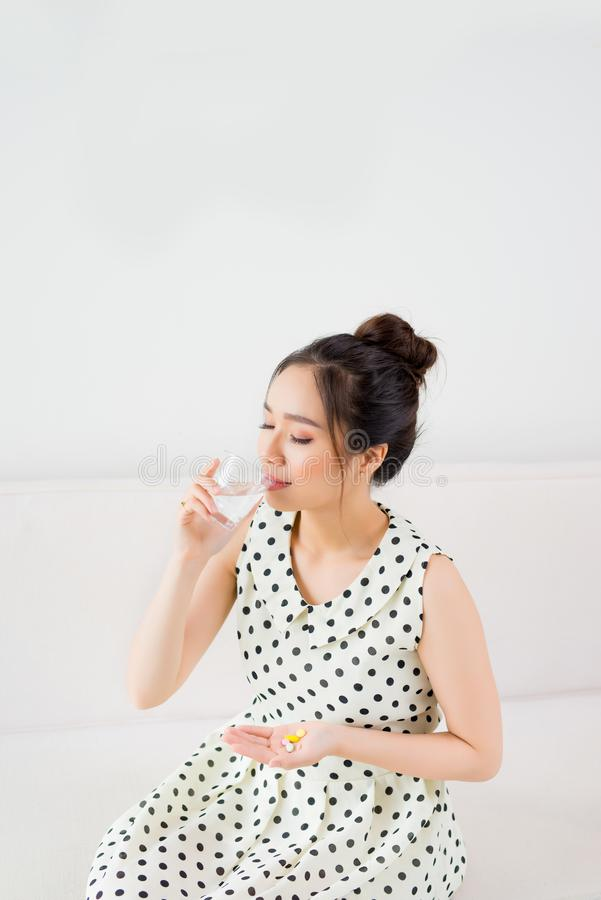 Upset Vietnamese woman on couch at home in the living room stock photos