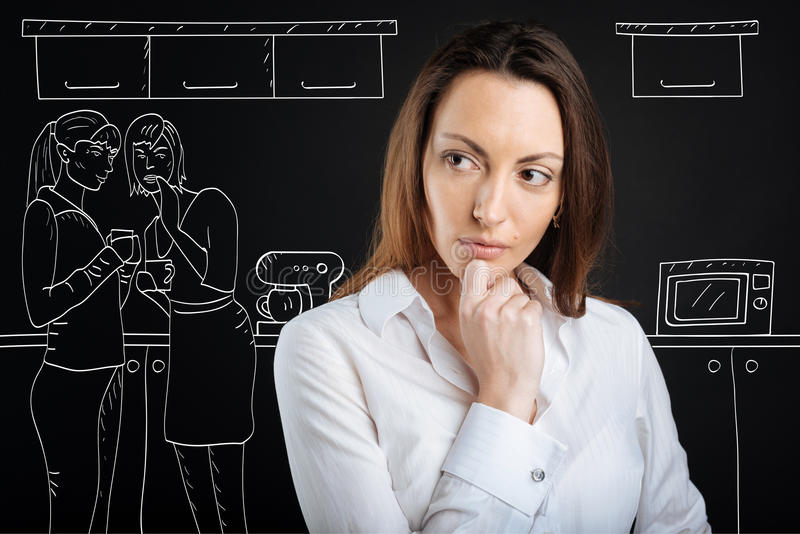 Upset woman being an object of gossipping of her friends stock photography