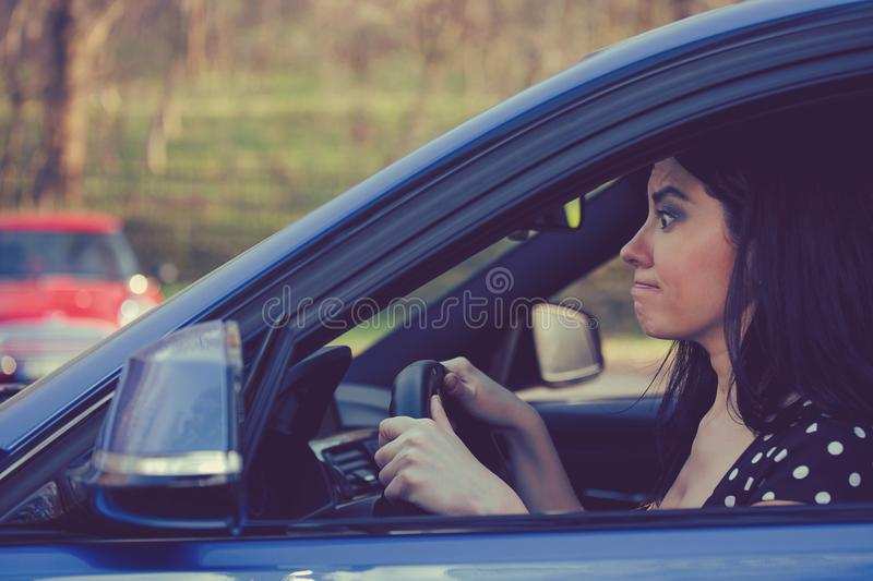 Upset woman driver inside her car in a heavy traffic royalty free stock photos